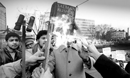 Salman Rushdie's Satanic Verses is burned by Muslims in Bradford, 1989.