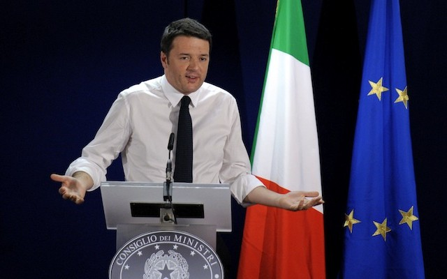Italy's PM Renzi holds a news conference at an European Union leaders summit in Brussels