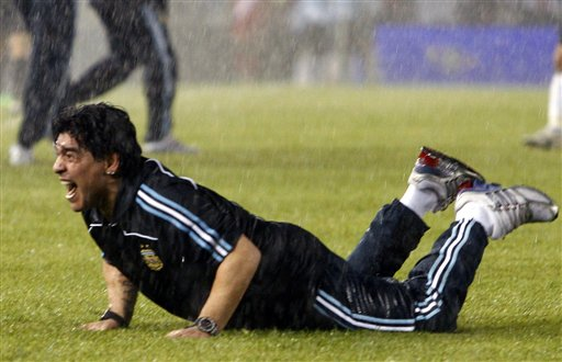 Under pouring rain, Argentina's coach Diego Maradona celebrates at the end of a 2010 World Cup qualifying soccer match against Peru in Buenos Aires, Saturday, Oct. 10, 2009. Argentina won 2-1. (AP Photo/Rodrigo Nespolo, La Nacion) ARGENTINA OUT - NO USAR EN ARGENTINA